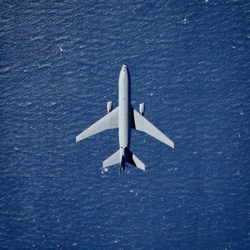 Plane flying above ocean