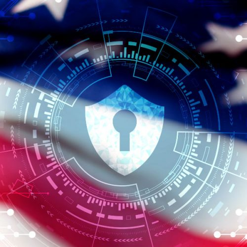 Abstract glowing shield with code going through and around an American Flag