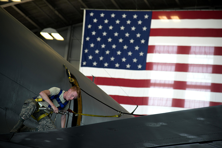 Man working on a military plane