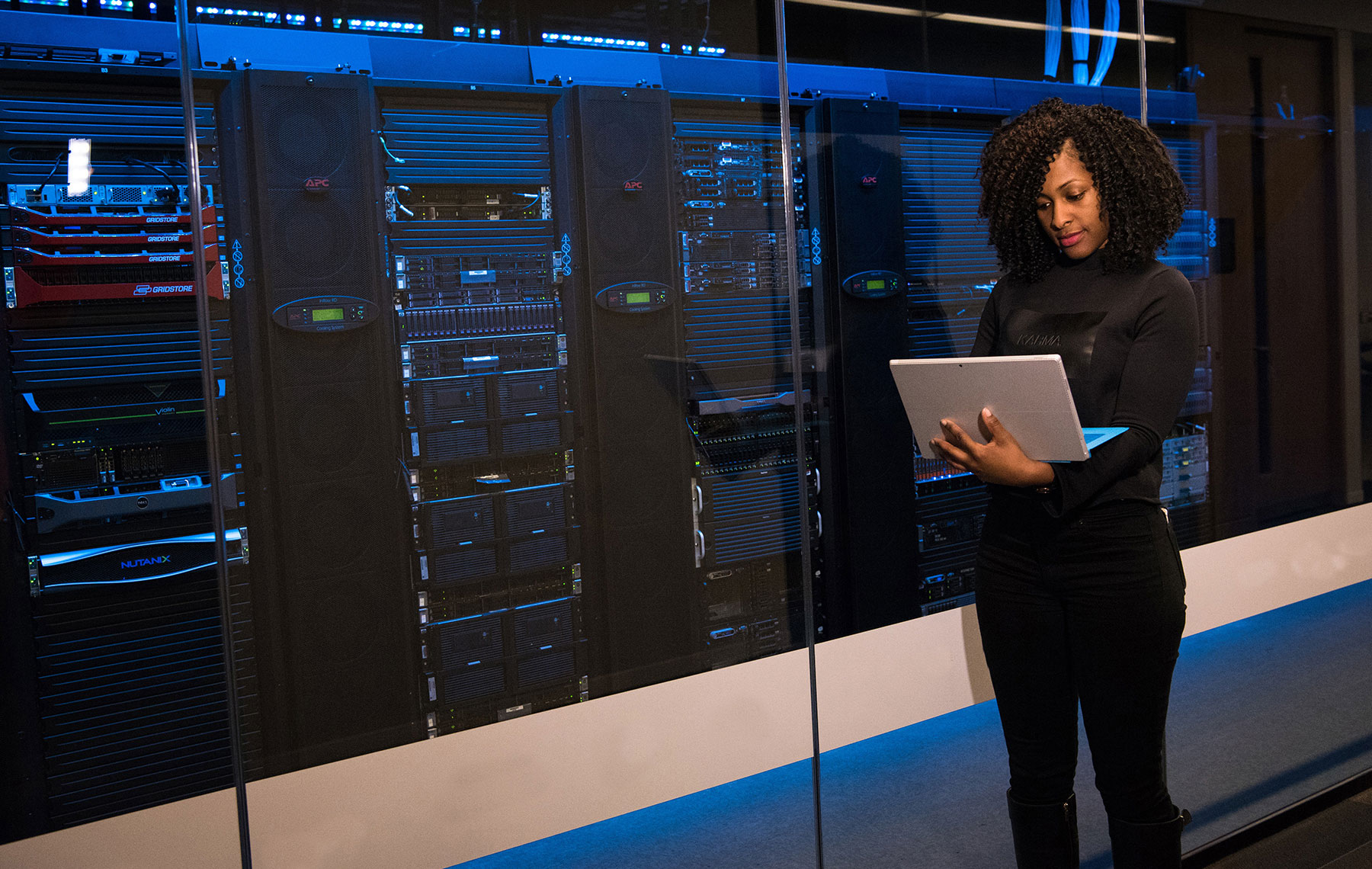 a woman in a data center lab