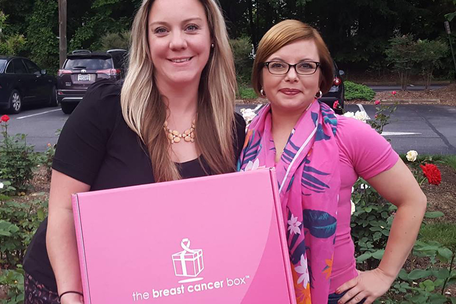 ECS employee with the breast cancer box founder