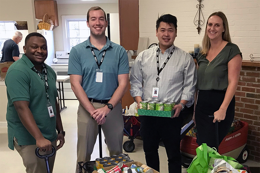 ECS employees donating to a food drive
