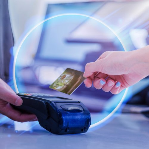 abstract image of someone checking out with credit card